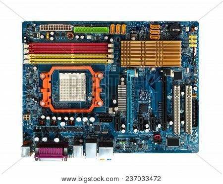 Motherboard  In Blue With Slots Pci,  Agp, Ddr, Cpu  Visible Heat Sink. View From Above With Clippin