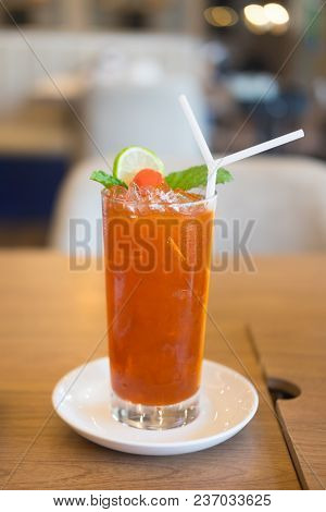 Iced Tea With Lime And Ice Cubes. Iced Cold Summer Drink