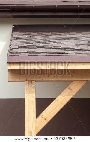 Asphalt Shingles Or Bitumen Tiles On The Terrace And Rooftop Outdoor.