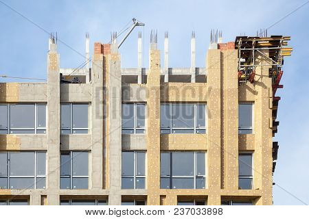 Unfinished Cement Building At A Construction Site. Energy Efficiency House Wall Renovation For Energ