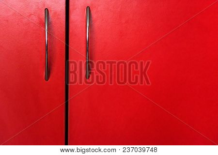Close Up Handles On Red Door Of Wooden Cabinet