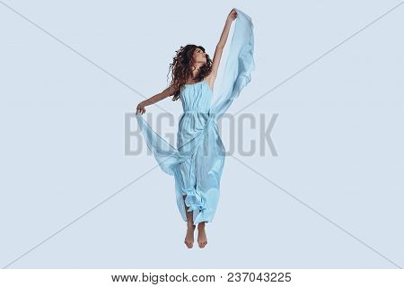She Is An Angel. Full Length Studio Shot Of Attractive Young Woman In Elegant Dress Looking Away Whi