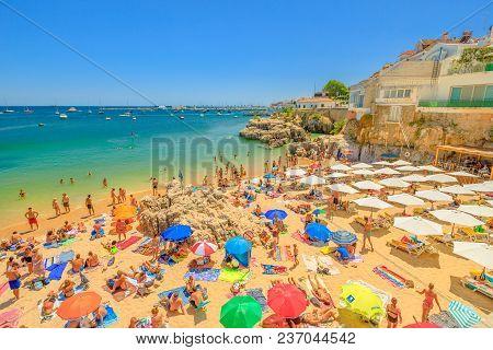 Cascais, Portugal - August 6, 2017: People Sunbathing On Praia Da Rainha, A Small Beach With Cliffs