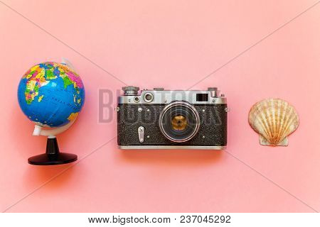 Flat Lay With Vintage Film Photo Camera, Globe And Shell On Pink Colourful Pastel Trendy Modern Fash