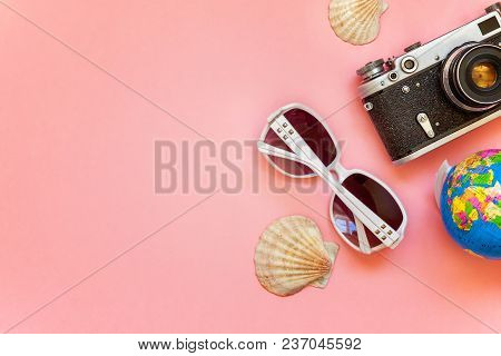 Flat Lay With Vintage Film Photo Camera, Sunglasses And Shell On Pink Colourful Pastel Trendy Modern