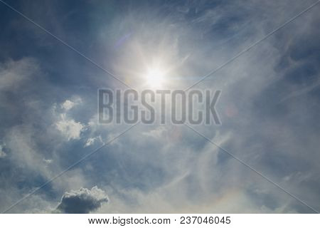 Beautiful Nature Background Of Blue Sky, Many Fluffy Sunny White Clouds And Bright Sunshine  Overhea