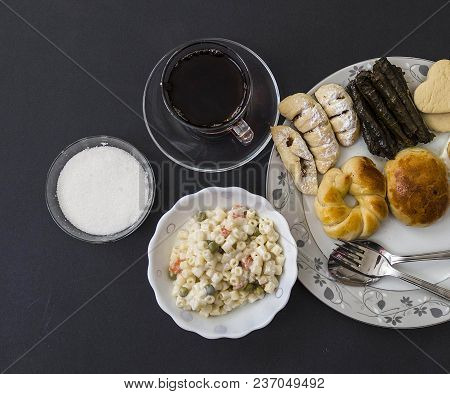 Snacks In A Plate, Pastry, Pastry, Leaf Wrapping, Ravioli And Hot Tea,