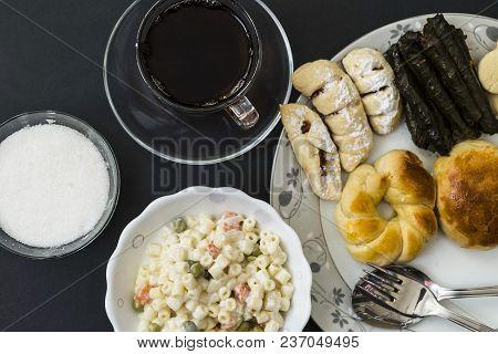 Snacks In A Dish, Cake, Pastry, Stuffed Vine Leaves, Ravioli And Alongside Hot Tea,