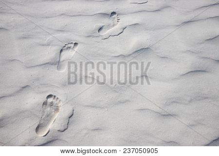 Foot Marks On White Sand Beach. Barefoot Walk Marks. Relaxing Day On Beach. Tropical Seaside. Exotic
