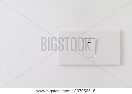 Electronic Switches With White Background, White Switches On Wall In Home, Closeup Switches Interior