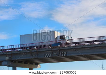 Truck Delivers Freight On Bridge Against Sky