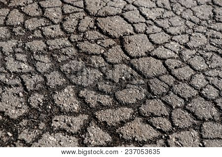 Lot Of Cracks On The Old Asphalted Road