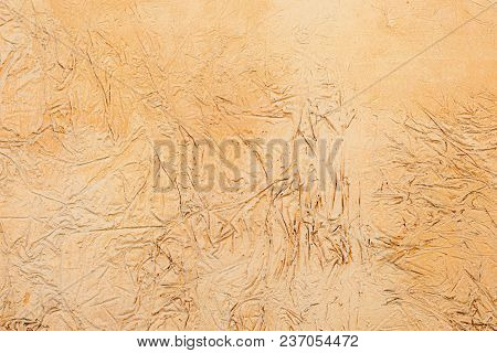 Background Of A Yellow Stucco Coated And Painted Exterior, Rough Cast Of Cement And Concrete Wall Te