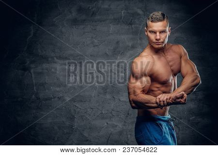 Shirtless Sporty Male Isolated With Contrast Illumination On Grey Vignette Background.
