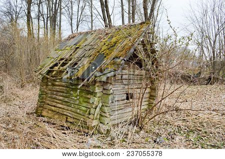 Old Old Dilapidated Small Wooden Abandoned Ruined, Rickety Broken Village House Of Beams, Logs And S