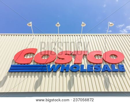 Lewisville, Tx, Usa- Apr 20, 2018: Logo Of Costco Storefront, Close Up Facade Entrance Cloud Blue Sk
