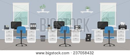 Office Room In A Blue Color. Workplace Of Office Workers With White Furniture On A Windows Backgroun