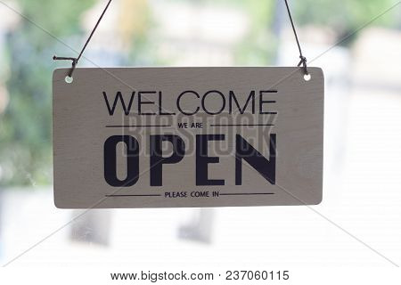 A Sign Hanging Open Coffee Shop Door,open Sign Blur Background,label Word Open
