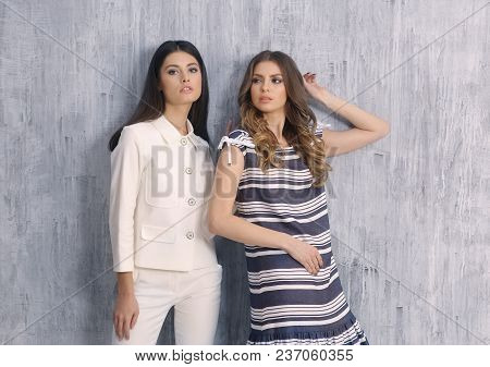 Two Model Girl In Summer Fashion Clothes White Pant Suit And Striped Short Sleeve Dress Full Body Ph