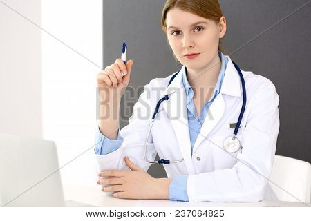 Female Doctor Filling Up Medical Form On Clipboard Closeup.  Physician Finishing Up Examining His Pa