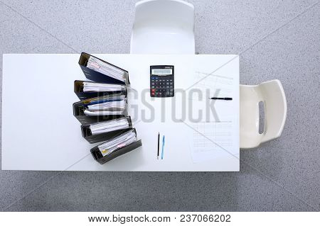 Binders With Papers Are Waiting To Be Processed With Bookkeeper. Internal Revenue Service Inspector