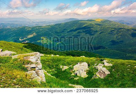 Rocky Formation On Grassy Hillside. Beautiful Nature Scenery In Summer