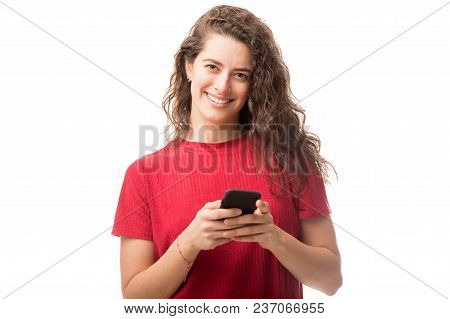 Good Looking Woman With Smart Phone Making An Eye Contact On White Background