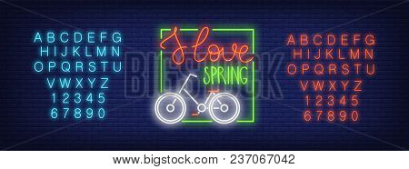 Neon Alphabet And I Love Spring Text With Bicycle In Frame Over Brick Background. Spring Sale, Bicyc