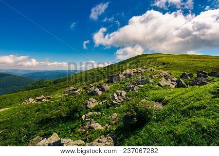 Huge Rocky Formation On The Grassy Hillside. Beautiful Landscape Of Runa Mountain On A Bright Summer