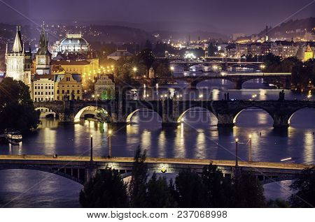 Night View Of Famous European Prague City - The Capital Of Czech Republic With Reflection In River V