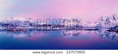 Landscape With Beautiful Winter Lake And Snowy Mountains At Sunset At Lofoten Islands In Northern No