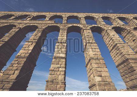 The Famous Ancient Aqueduct In Segovia, Castilla Y Leon, Spain