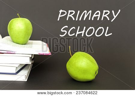 Concept Back To School, Text Primary School, Two Green Apples, Open Books On Gray Background