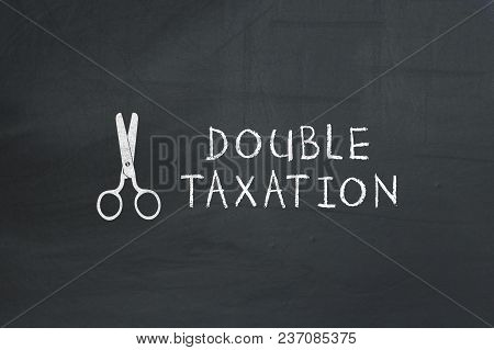 Scissors With Goods And Services Tax Text On Chalkboard.