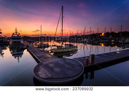 A Majestic Sunrise With Boat Resting Near   The Dock As Foreground At Putri Harbour, Iskandar Malays