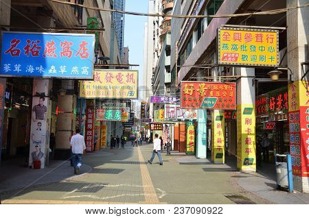 Macau, China- 7 Apr, 2018: Advertisement  Signs On A Street In Macau.