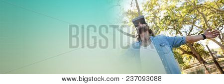Low angle of man in virtual reality headset embracing forest and green transition