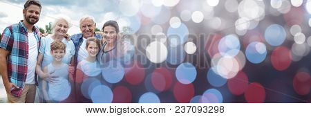 Family smiling outside with red and blue bokeh transition
