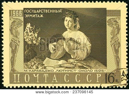 Ukraine - Circa 2018: A Postage Stamp Printed In Ussr Show Lute Player 1596 By Michelangelo Merisi D