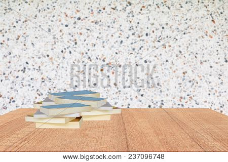 Books Stack On Wooden Shelf In Library School Concept With Wall  Polished Stone Blur Background Copy