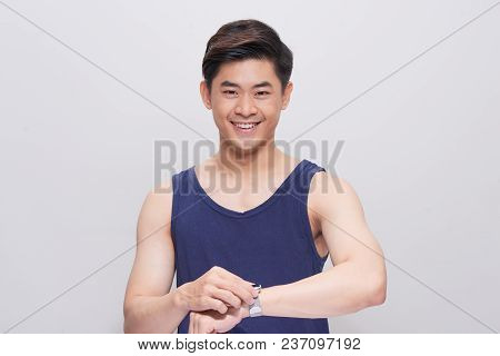 Handsome Young Asian Man Watching On His Watch In White Background