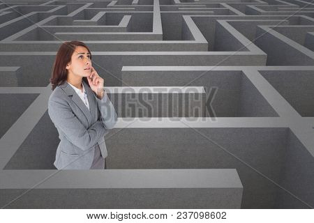 Woman thinking in a maze