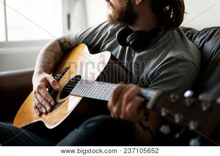 Caucasian man in a songwriting process