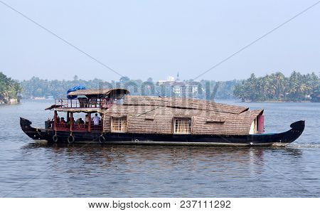 Alleppey, India - November 5, 2016: Tourists On Houseboat Floating On Backwaters In Kerala State, So