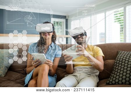 Happy couple in VR headsets looking at interface