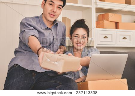 Sme Business Concept. Young Asian People Are Packing Their Packages.delivery Business  Small And Med