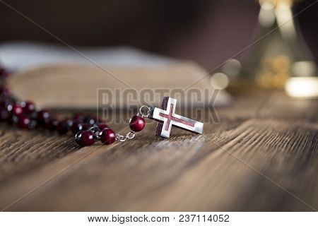 First Holy Communion Theme. Holy Bible, Golden Chalice And Rosary On Wooden Table.