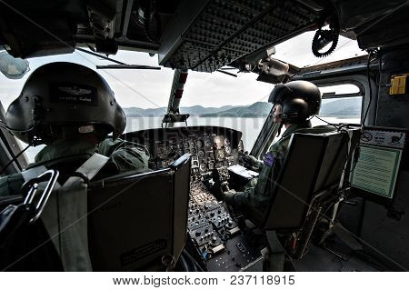PRANBURI, THAILAND - December 4, 2016 - Cockpit interior details of Army helicopter with pilot and c