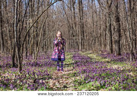 Little Girl Among The Flowers And Trees, Summer Vacation In The Forest Concept