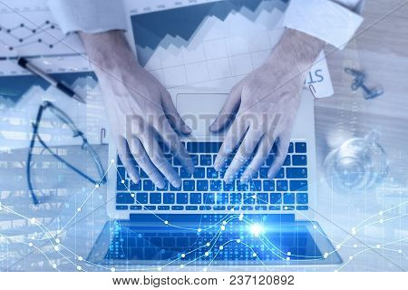 Hands Using Laptop With Forex Graph In Modern Office. Trade, Accounting And Finance Concept. Double